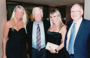 Dr Ken MacTaggart with Gene Cernan & two Bond Girls